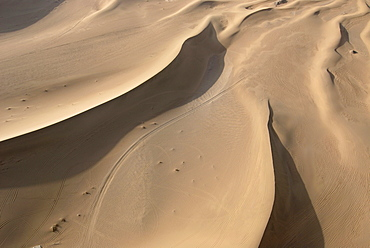 Aerial view of sand dunes in the Gobi desert with caravan route, Silk Road, Dunhuang, Gansu, China, Asia