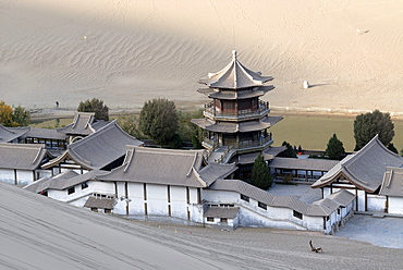 View from the sand dunes of the Gobi Desert over the Crescent Lake with the Chinese Pagoda in Dunhuang, Silk Road, Gansu, China, Asia