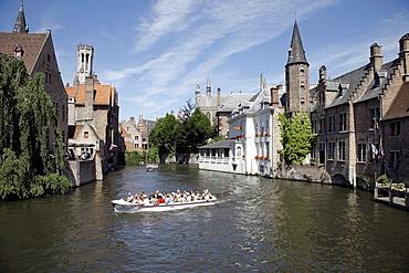 Boat tour through canals, historic center of Bruges, Flanders, Belgium, Europe