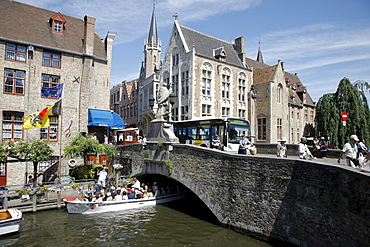 Mooring for boat tours through canals, historic center of Bruges, Flanders, Belgium, Europe