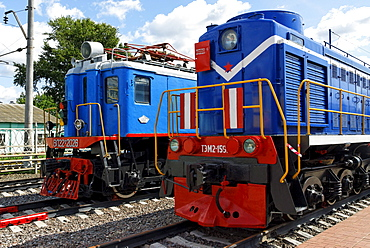 Two Soviet diesel and electric locomotives as exhibits of the Moscow Railway Museum, Moscow, Russia
