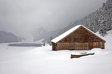 Alpine hut in winter mood, in the back back the Saemtisersee see in the Alpstein range, Switzerland, Switzerland, Europe