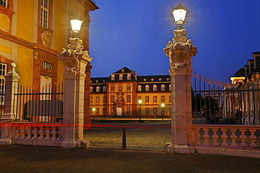 Entrance to Bruchsal Castle with lanterns on the gate at twilight, Bruchsal, Baden-Wuerttemberg, Germany, Europe
