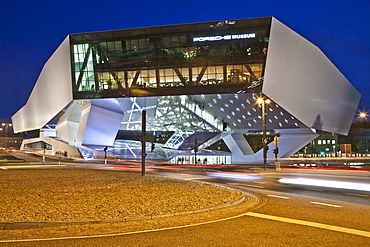 Porsche Museum in Stuttgart-Zuffenhausen, car museum, modern architecture, illuminated in the evening, opening in 2009, Stuttgart, Baden-Wuerttemberg, Germany, Europe