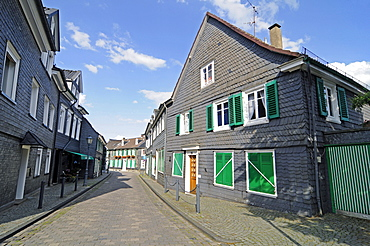 Half-timbered houses, slate cladding, street, historic centre, Hueckeswagen, Bergisches Land area, North Rhine-Westphalia, Germany, Europe