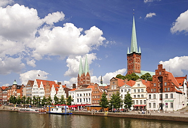 At the upper Trave river, in the back the churches of St. Petri and Marienkirche, St. Mary's of Luebeck, Luebeck, Schleswig-Holstein, Germany, Europe