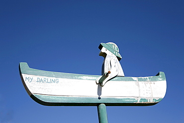 Fisherman in his boat as a woodcarving, Schleswig-Holstein, Northern Friesland, Northern Germany, Germany, Europe