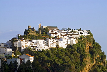 White houses and the castle of Casares in soft evening light, Andalusia, Spain, Europe