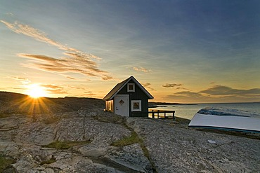 Cabin with row boat, sunset, Smoegen, Bohuslaen, Sweden