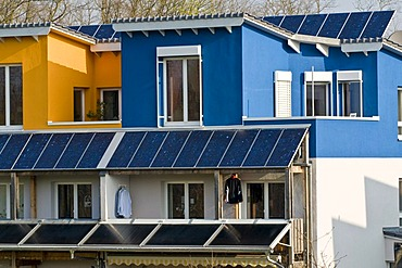 Colourful front with solar modules on a residential house, Freiburg, Baden-Wuerttemberg, Germany