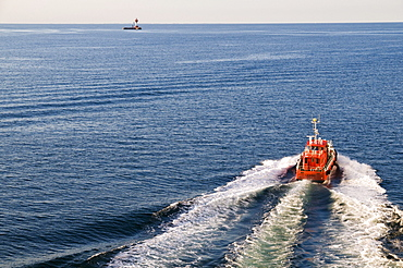 Pilot boat and lighthouse