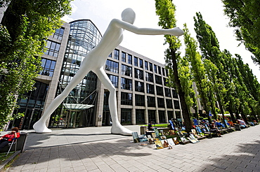 Walking Man, sculpture by Jonathan Borofsky, 1995, in front of the building of the Muenchener Rueckversicherung insurance company, Leopoldstrasse street, Schwabing, Munich, Upper Bavaria, Germany, Europe