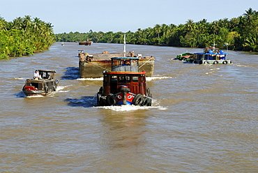 Ships and boats on the Mekong River, Vietnam, Asia