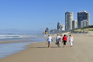 People walking on the beach at Surfers Paradise, Gold Coast, Queensland, Australia