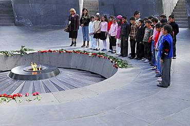 School children in the Armenian Genocide Memorial Tsitsernakaberd with eternal flame, Yerevan, Armenia, Asia
