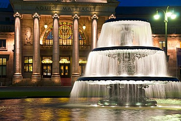 Bowling Green, fountain at night, dusk, Kurhaus, historic spa hotel and convention center, Wiesbaden, Hesse, Germany