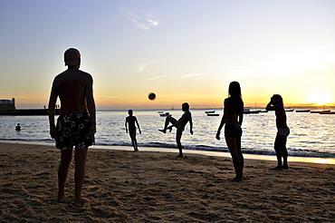 Football at sunset on the beach of Porto da Barra, Salvador, Bahia, Brazil, South America