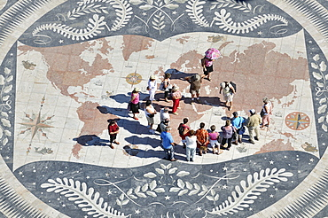 Tourists on a giant world map at the foot of the Monument to the Discoveries, Padrao dos Descobrimentos, Belem, Lisbon, Portugal, Europe