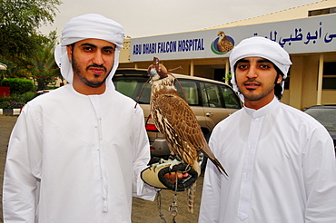 Two locals with their falcons at the Abu Dhabi Falcon Hospital, Abu Dhabi, United Arab Emirates, Arabia, Middle East, Orient