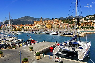 Catamaran by the marina at the old port of Menton, Cote d'Azur, France