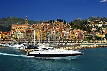Luxury yacht leaving the old port of Menton, Cote d'Azur, France