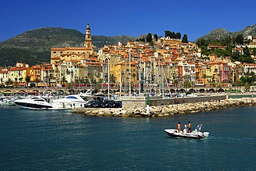 Zodiac boat returning to the old port of Menton, Cote d'Azur, France