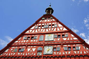 Half-timbered gable of the historial town hall of Grossbottwar with clock, sun dial and stork as heraldic animal, Grossbottwar, Baden-Wuerttemberg, Germany, Europe