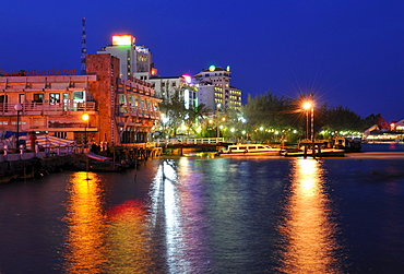 Lighted Houses in Can Tho in the evening reflections on the Mekong, Mekong Delta, Vietnam, Southeast Asia