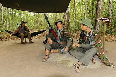 Dolls, armed Vietnamese soldiers sitting in a jungle camp, Cu Chi caves, Vietnam, Southeast Asia