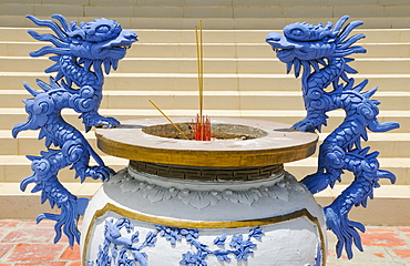 Two blue dragons on a Buddhist incense bowl, Mui Ne, Vietnam, Asia