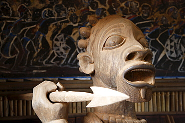 Woodcarved warrior in the Tam-Tam House, Foumban, Cameroon, Africa