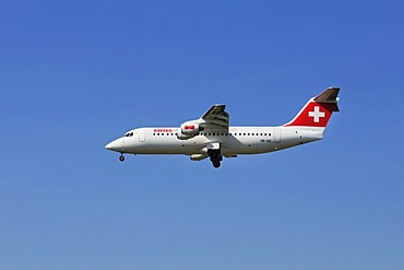 Swiss Air airplane Swiss Avro Regional Jet RJ100 is swinging out its landing gear