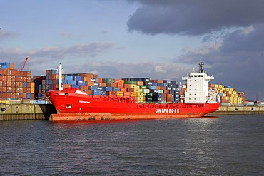 Feeder vessel, freight ship and container in Hamburg harbour, Hamburg, Germany