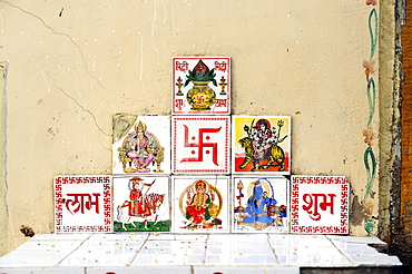 Tiles with Indian, Hindu deities and the Swastika for good luck, Sunrise icon, Jaisalmer, Rajasthan, North India, India, South Asia, Asia