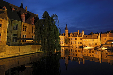 Water reflection on River Dijver at dusk, Bruges, Flanders, Belgium, Europe