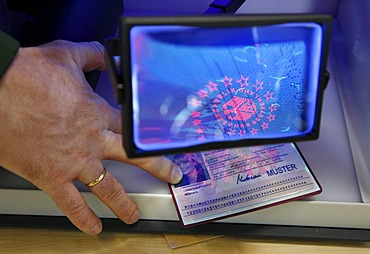 Police inspection, validating documents, passport, using UV light and a magnifying glass, mobile control station of the highway patrol, Muenster, North Rhine-Westphalia, Germany, Europe
