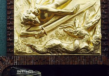 """Entrance to the Boettcherstrasse street, golden relief """"Der Lichtbringer"""", bringer of light, by Roland Hoetger, Bremen, Germany, Europe"""
