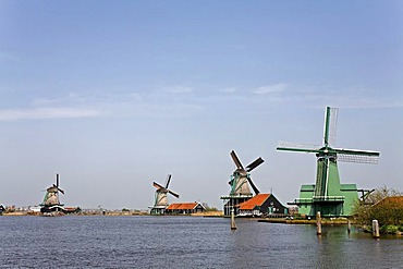Historic windmills at the river Zaan, open-air museum Zaanse Schans, Zaanstad, Province of North Holland, Netherlands, Europe