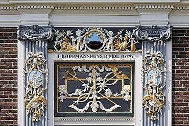 Elaborate ornaments on the portal of a Dutch merchant house from the 18th century, open-air museum Zaanse Schans, Zaandam, North Holland, Netherlands, Europe