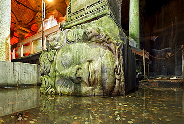 Monumental head of a medusa at the foot of a column, Yerebatan Sarayi, Byzantine cistern, Sultanahmet, Istanbul, Turkey