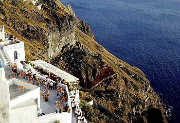 Tavern on the cliffs, overlooking the sea, Fira town, Santorini, Thira, Cyclades, Greece, Europe
