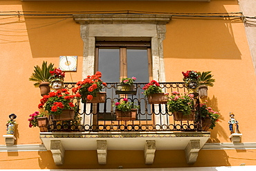 Decorated balcony with flowers by Corso Umberto by Piazza IX Aprile, Taormina, Sicily, Italy