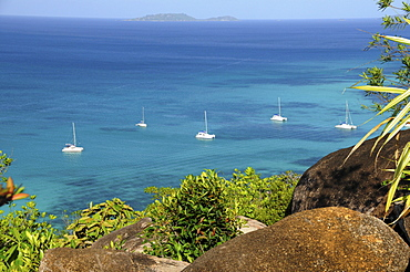 Sailing boats in front of the Anse Volbert, Cote d'Or, Praslin Island, Seychelles, Africa, Indian Ocean