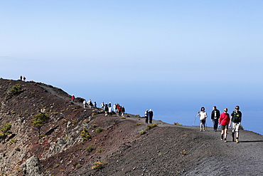Tourists on the crater rim of the volcano Fuencaliente at San Antonio, La Palma, Canary Islands, Spain, Europe