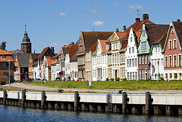 Glueckstadt, historic row of houses at the inland port with Wiebke Kruse-tower in the back, district Steinburg, Schleswig-Holstein, Germany, Europe