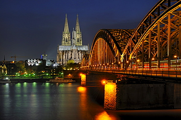 Hohenzollern bridge and Cologne Cathedral by night, North Rhine-Westphalia, Germany, Europe