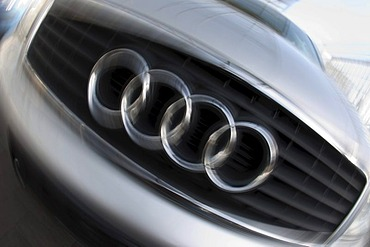 Grille face panel with the company logo of the automobile brand AUDI, motion blur, Germany