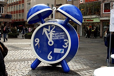 Blue alarm clock as an advertisement on the street, Nuremberg, Middle Franconia, Bavaria, Germany, Europe
