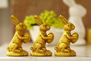 Easter decoration, three golden Easter bunny figurines, Villa Ambiente, Nuremberg, Middle Franconia, Bavaria, Germany, Europe