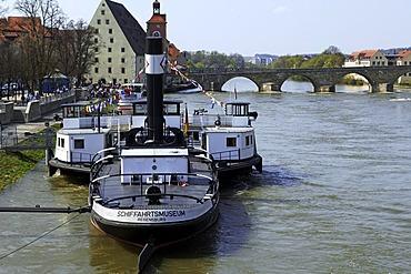 Maritime museum on Danube River, Historische Wurstkueche Restaurant and Steinerne Bruecke Bridge in the back, Regensburg, Upper Palatinate, Bavaria, Germany, Europe